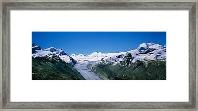 Snow Covered Mountain Range With A Framed Print