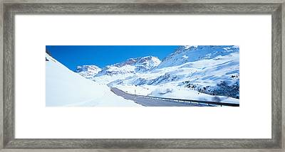 Snow Covered Mountains On Both Sides Framed Print