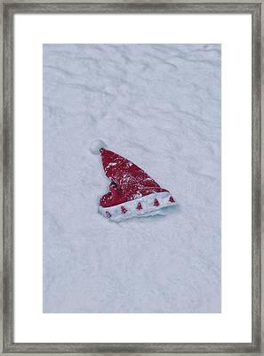 snow-covered Santa hat Framed Print by Joana Kruse