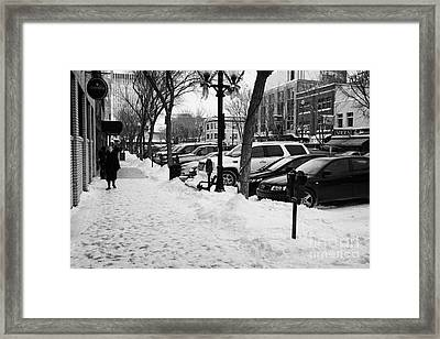 snow covered sidewalk in downtown Saskatoon Saskatchewan Canada Framed Print