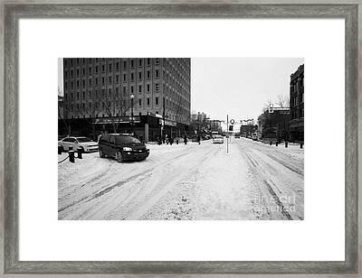 snow covered streets in downtown Saskatoon Saskatchewan Canada Framed Print