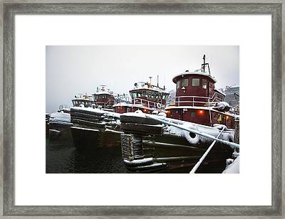 Snow Covered Tugboats Framed Print