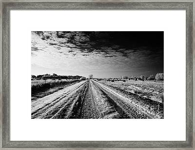 snow covered untreated rural small road in Forget Saskatchewan Canada Framed Print