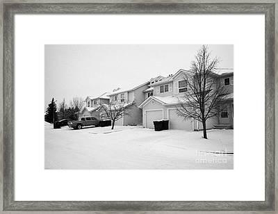 snow falling in residential street during winter Saskatoon Saskatchewan Canada Framed Print
