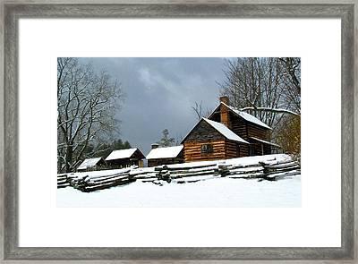 Snow Falls On The Homestead Framed Print