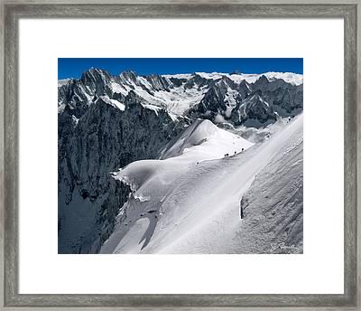 Snow Hikers Framed Print