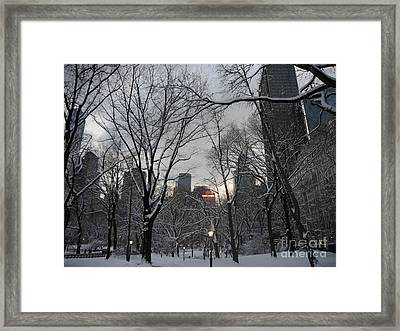 Snow In The City Framed Print by Winifred Butler