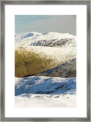 Snow On The High Street Fells Framed Print by Ashley Cooper