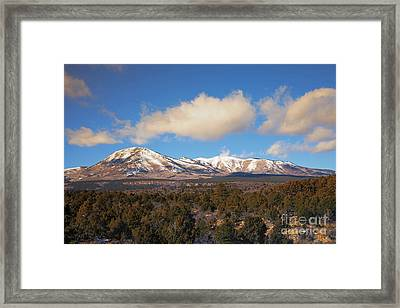 Snow On The Peaks Framed Print by Mike Dawson
