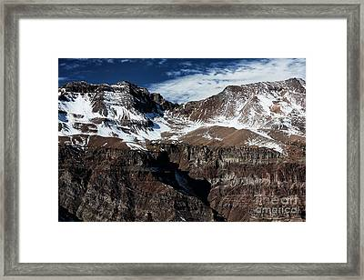 Snow On The Top Framed Print by John Rizzuto
