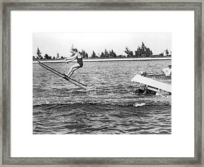 Snow Skis On Water Framed Print by Underwood Archives