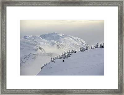 Snowboarders And Skiers Enjoy The Framed Print