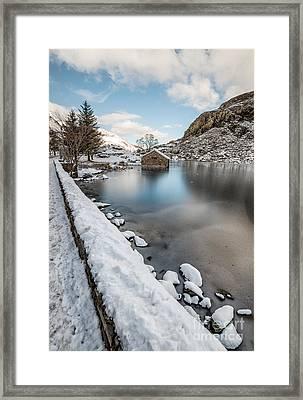 Snowcapped Framed Print by Adrian Evans