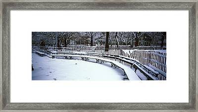 Snowcapped Benches In A Park Framed Print