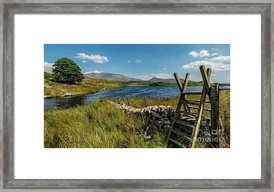 Snowdon Stile Framed Print by Adrian Evans