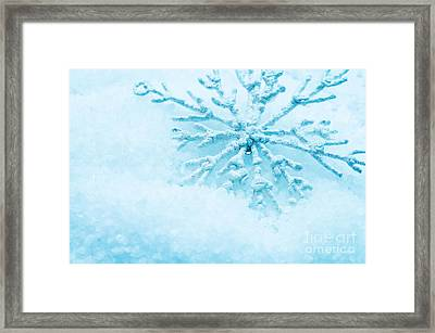 Snowflake In Snow Framed Print by Michal Bednarek