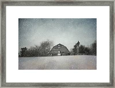 Snowing At The Old Barn Framed Print