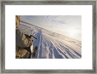 Snowmachiner Following Trail On Frozen Framed Print by Kevin Smith