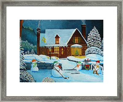 Snowmans Hockey Framed Print by Anthony Dunphy