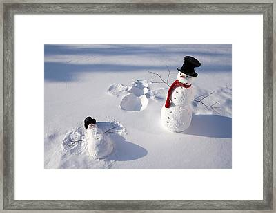 Snowmen In Forest Making Snow Angel Framed Print
