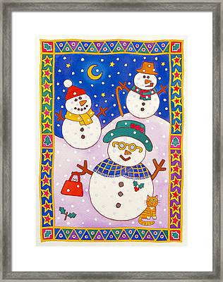 Snowmen In The Snow  Framed Print by Cathy Baxter