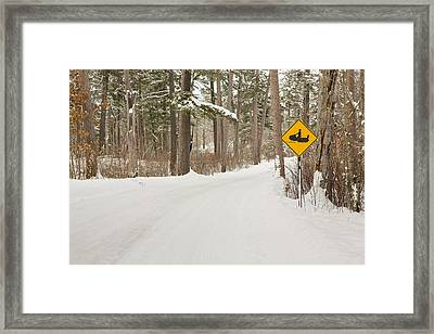 Snowmobile Crossing Framed Print by Tim Grams