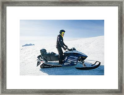 Snowmobilers Framed Print by Ashley Cooper