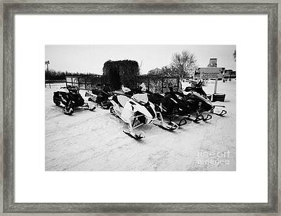 snowmobiles parked in Kamsack Saskatchewan Canada Framed Print by Joe Fox