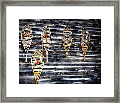 Snowshoes On A Wooden Barn Framed Print