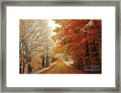 Snowy Autumn Road Framed Print