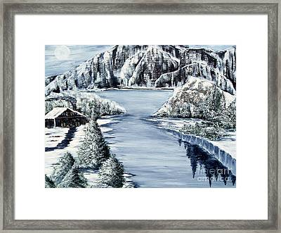 Snowy Cabin By The Lake Framed Print