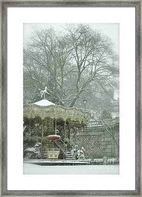 Snowy Carousel Framed Print