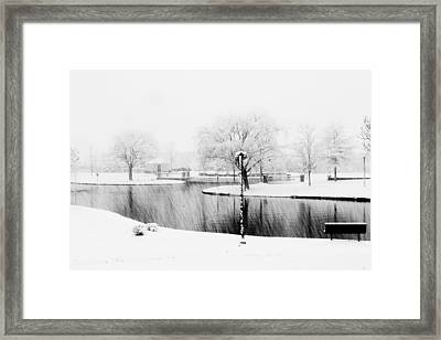 Snowy Day On Man Made Pond Framed Print