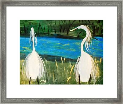 Snowy Egrets At The Pond Framed Print by Marie Bulger