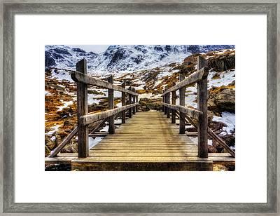 Snowy Footbridge Framed Print by Ian Mitchell
