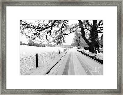 Snowy Lane Framed Print by Adrian Evans