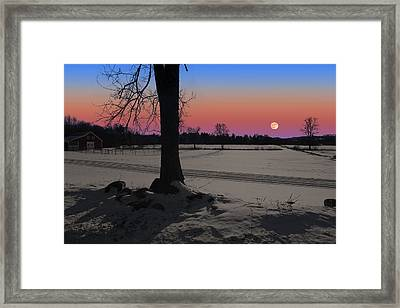 Framed Print featuring the photograph Snowy Moonrise by Larry Landolfi