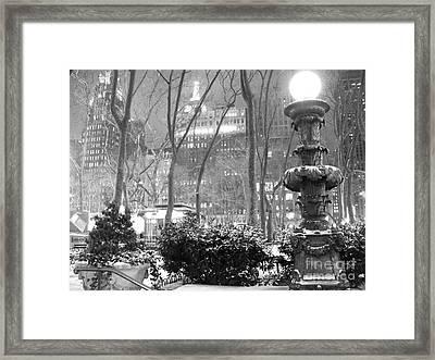 Snowy Night In Bryant Park II Framed Print by Miriam Cintron