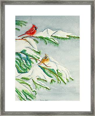 Snowy Pines And Cardinals Framed Print