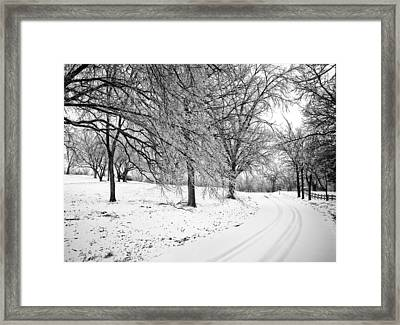 Snowy Road Framed Print by Eric Benjamin