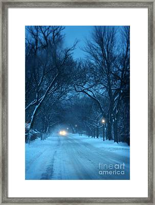 Snowy Road On A Winter Evening Framed Print
