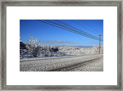 Snowy Roads Framed Print by Michael Mooney