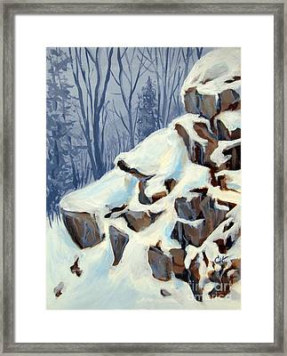 Snowy Rocks Framed Print