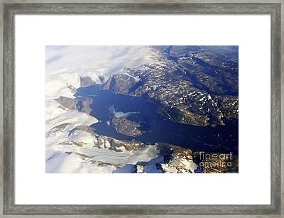 Snowy Rocky Coastline And Floating Icebergs On Ocean Framed Print by Sami Sarkis