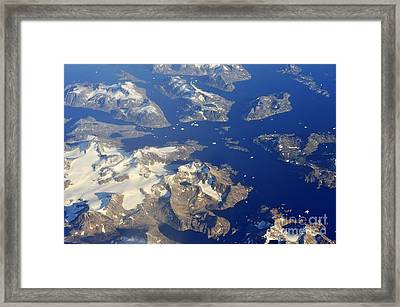 Snowy Rocky Islands And Floating Icebergs On Ocean Framed Print by Sami Sarkis