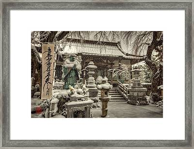 Snowy Temple Framed Print