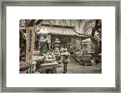 Snowy Temple Framed Print by John Swartz