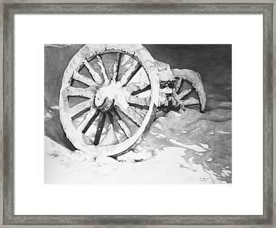 Snowy Wheel  Framed Print by Aaron Spong