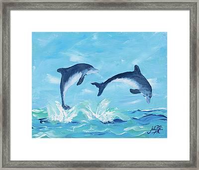 Soaring Dolphins II Framed Print by Julie Derice