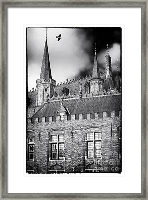 Soaring In Bruges Framed Print by John Rizzuto